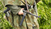 German soldier holding MP- 40 — Stock Photo