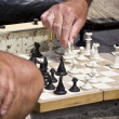 Stock Photo: Chess board and hands of