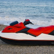 Royalty-Free Stock Photo: Red jet ski in the beach sea