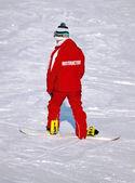 Instruktor jazdy na nartach na stoku góry — Zdjęcie stockowe
