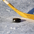 Hockey stick and puck on the ice — Stok fotoğraf