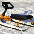 Child's sled in the snow on snow background - Foto Stock
