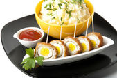 Meatballs with quail eggs and potatoes — Stock Photo