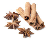 Cinnamon sticks and anise stars close-up on white background — Stock Photo