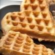 Waffle in heart shape isolated on black - Stock Photo