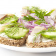 Sandwiches with herring, cucumber and dill — Stock Photo