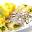 Portion of a herring with a potato and fennel — Stock Photo