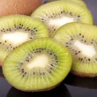Fresh kiwi isolated on black background - Stock Photo