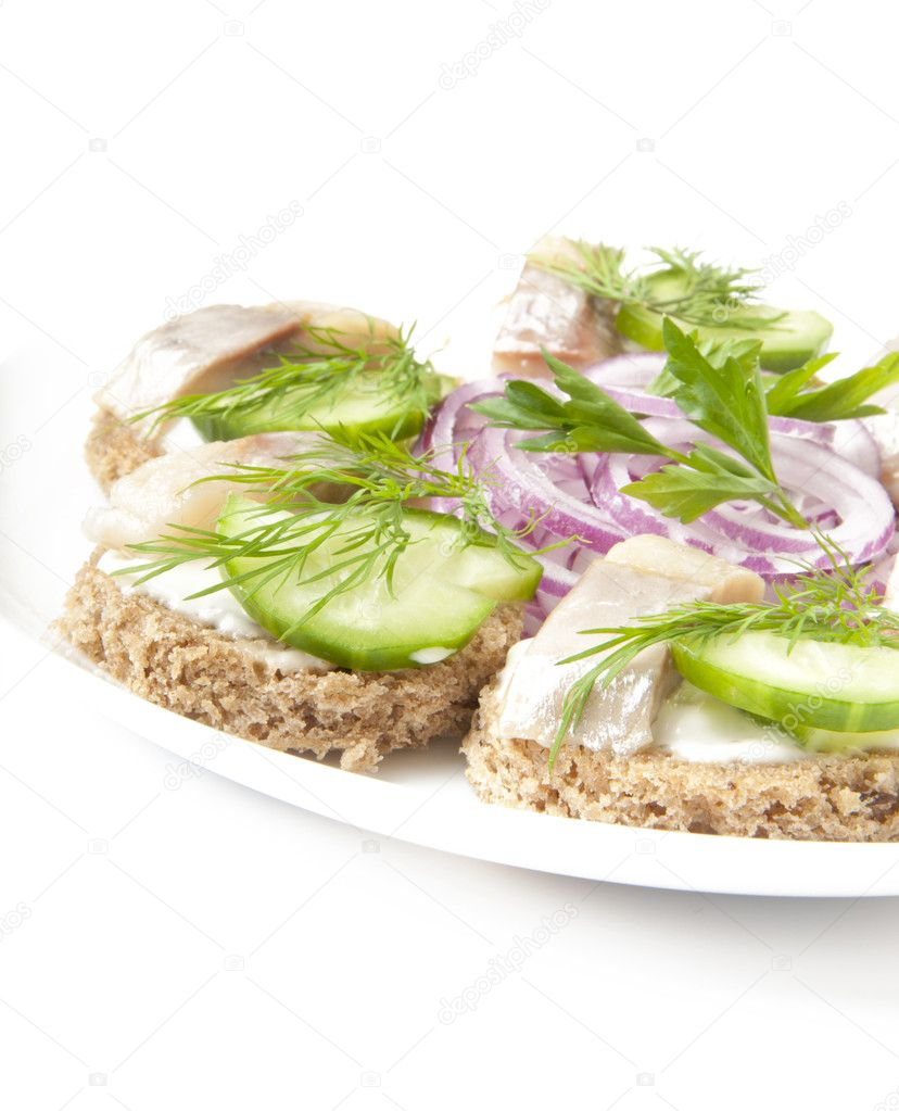 Sandwiches with herring, cucumber and dill — Stock Photo #8307372