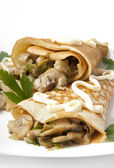 Pancakes with mushrooms — Stock Photo