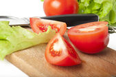 Tomatoes on a chopping board — Stock Photo