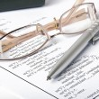 Ballpoint pen,glasses and report — Stock Photo