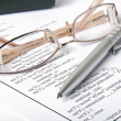 Ballpoint pen,glasses and report — Stock Photo #8505285