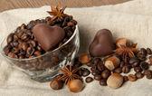 Coffee grains, wood nut and chocolate — Stock Photo