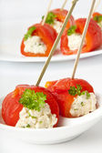 Appetizer of sweet peppers with cream cheese — Stock Photo