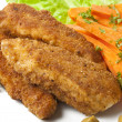Chicken fried in breadcrumbs with vegetables - Stock Photo