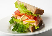 Sandwich with boiled red fish — Stock Photo