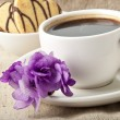 Cup of coffee and cookies with chocolate and violet - Stock Photo