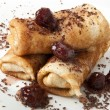 Pancakes with chocolate and strawberry syrup — Zdjęcie stockowe