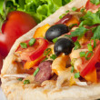 Closeup of pizza with tomatoes, cheese, black olives and peppers. — Stock Photo