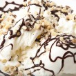 Vanilla ice cream with chocolate and nuts - Photo