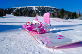 Pink and white snowboard — Stock Photo