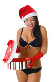 Cute and sexy girl in lingerie and a christmas hat looking a gif — Stock Photo