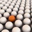 Orange golf ball among white balls — Stock Photo