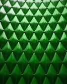 Green leather upholstery with a light coming from above. — Stock Photo