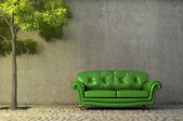 Abstract scene with a couch on a side walk — Stock Photo