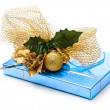 Gift box with decoration — Stock Photo