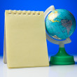 Notepad with globe — Stock Photo