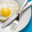 Fried egg on a plate — Stock Photo