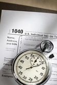 Tax form and stopwatch — Stock Photo
