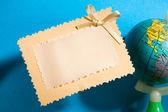 Greeting card and globe — Stock Photo