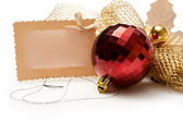 Christmas-tree decorations and card — Stock Photo