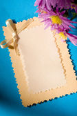 Greeting card and flowers — Stock Photo