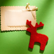 Greeting card and reindeer - Stock Photo