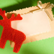 Greeting card and reindeer — Stock Photo
