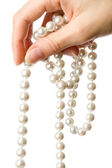 Pearl in the woman's hand — Stock Photo
