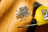 Hammer, tape measure and nails — ストック写真