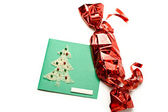 Large red candy and Christmas card — Stock Photo