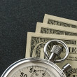 Stock Photo: Stopwatch and dollar