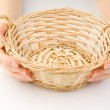 Hands and basket on white - Stock Photo