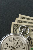 Stopwatch and dollar — Stock Photo