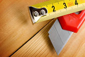 Tape measure and knife — Stock Photo