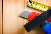 Tape measure, hammer and knife — Stock Photo