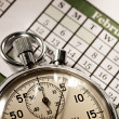 Monthly calendar and stopwatch - Stock Photo