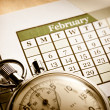 Stock Photo: Monthly calendar and stopwatch