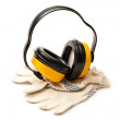 Headphones and pair of working gloves - Stock Photo